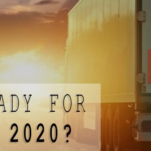 "Semi truck driving into the sunset with text reading ""Are You Ready For Road Check 2020?"""